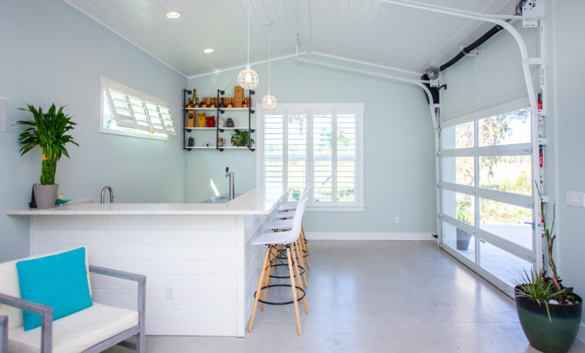 Garage home addition in Jacksonville with bar